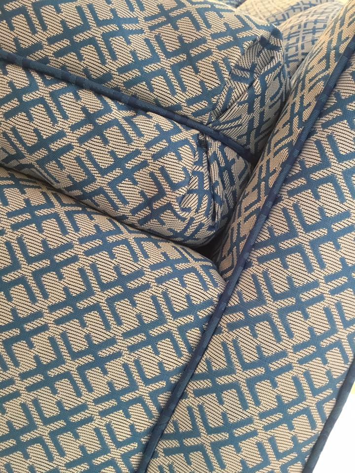 Upholstered barrel chair with contrast blue welt cord, Tobi Fairley fabric for Duralee.