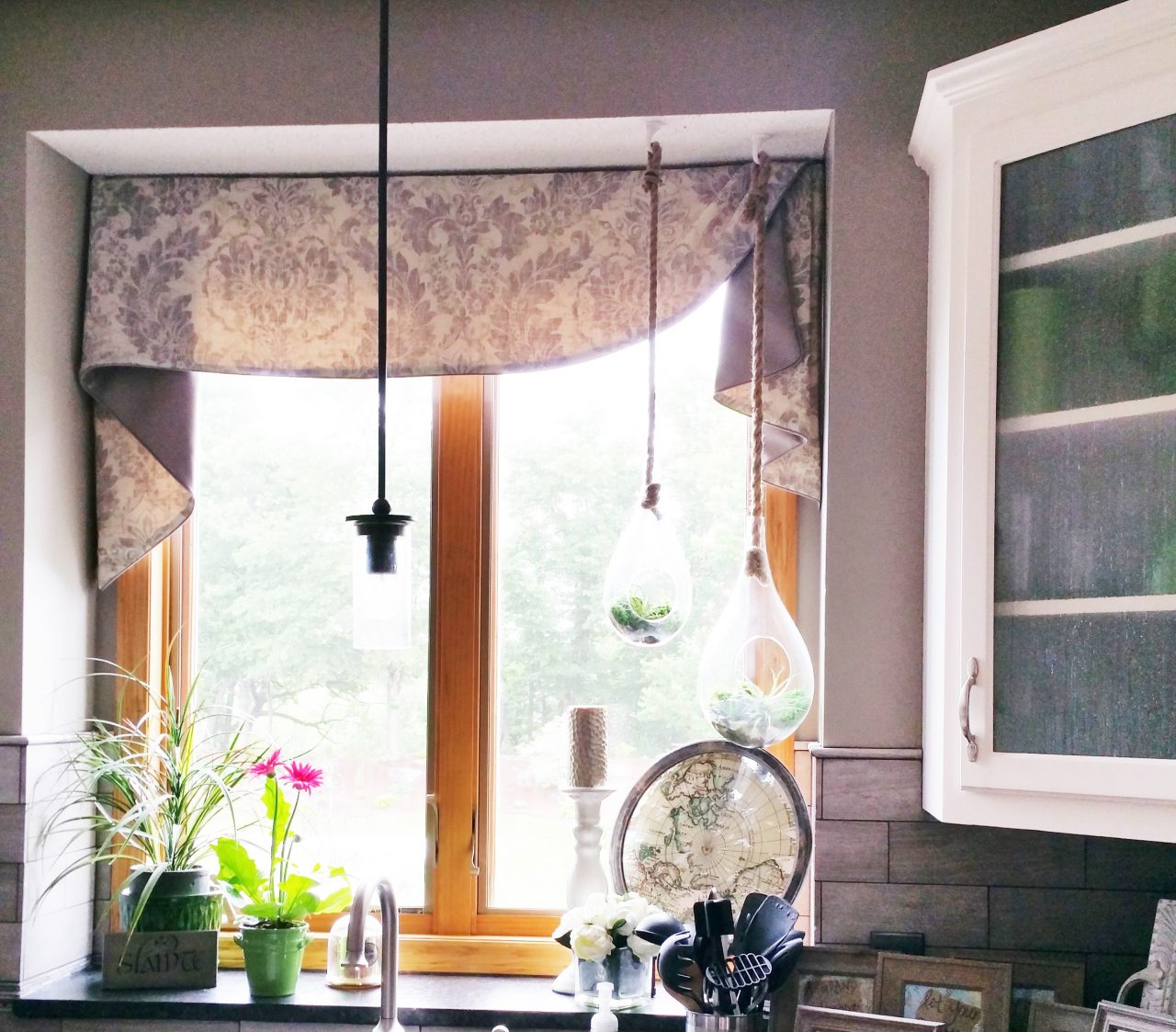Kitchen sink window with asymmetrical Moreland valance with Trend jacquard fabric and gray contrast within the jabots.