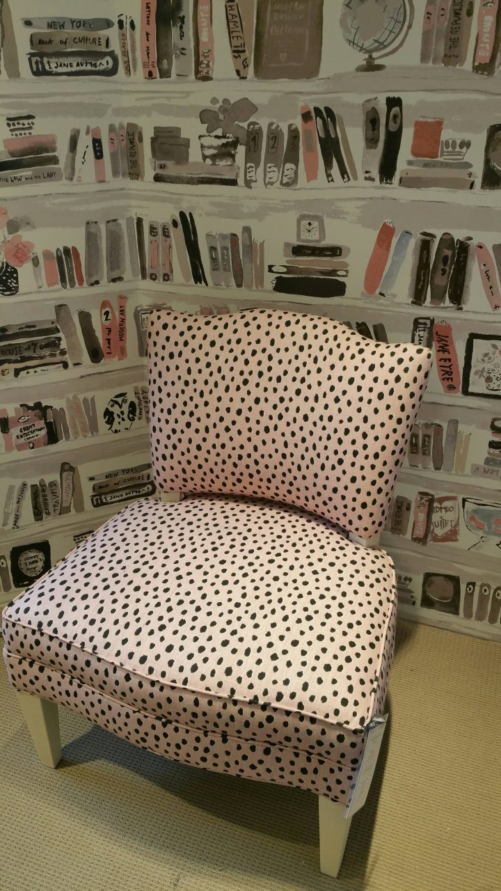 Custom upholstered chair in pastel pink animal print with matching welt cord. Kravet fabric and wallpaper.