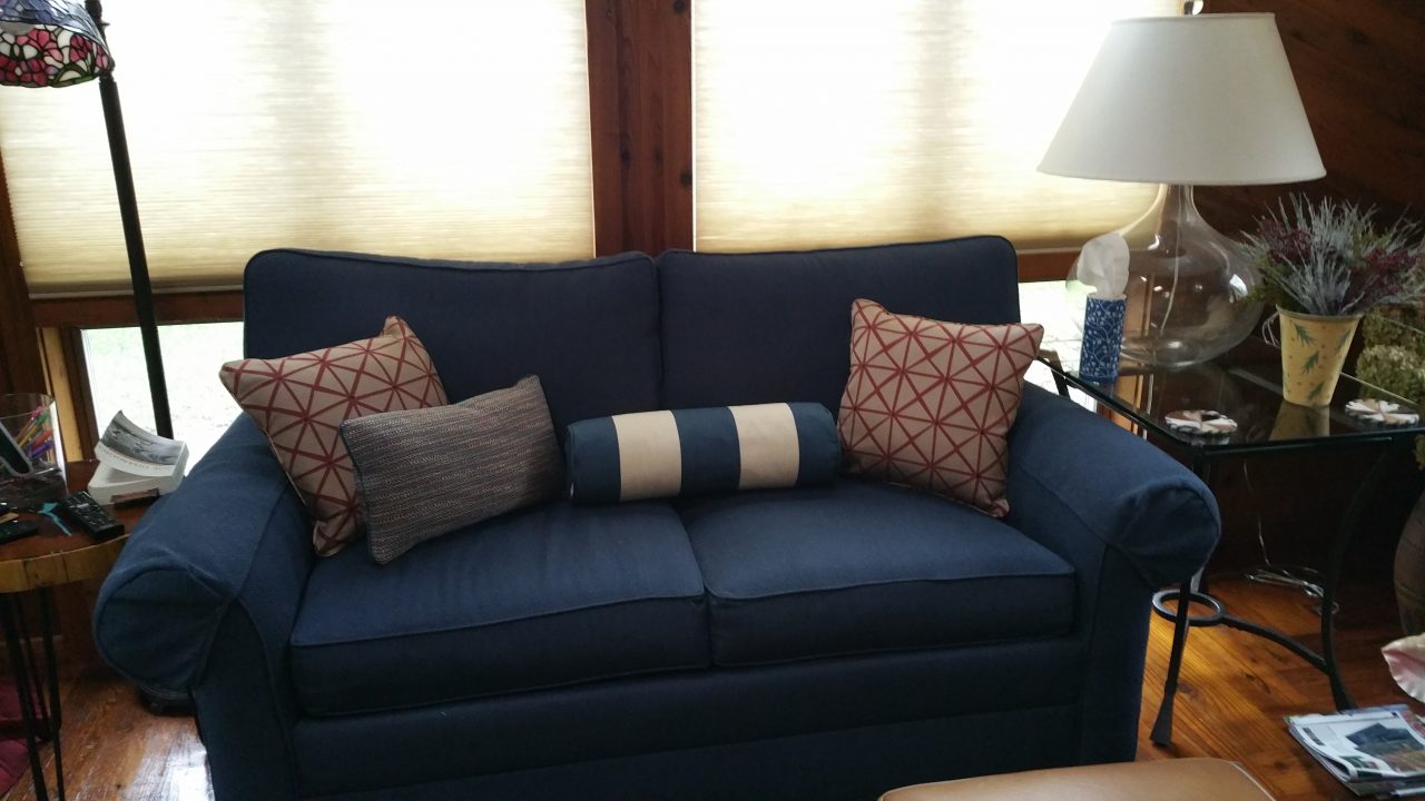 Decorative pillows on upholstered couch. blue and white striped cotton, tweed fabric, Fabricut fabric