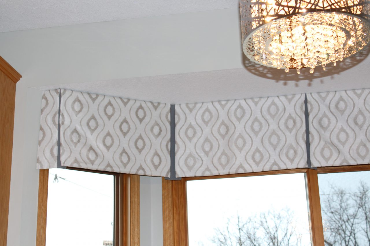 This bay, box pleated window treatment was created with a coordinating fabric within the pleat to highlight the design. Fabrics are from Trend and Fabricut.