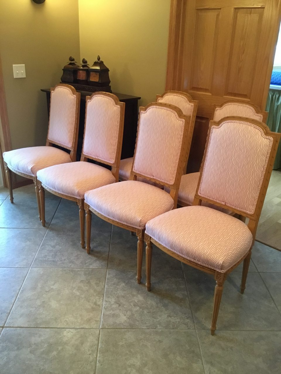 Upholstered set of light wood dining room chairs with double welt cord, Fabric by Kendall Wilkinson for Fabricut.