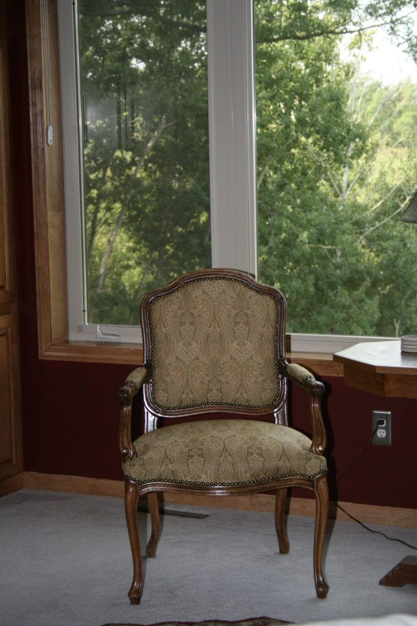 This formal side chair was reupholstered in a green paisley fabric from RM Coco to coordinated with the rest of this clients decor.