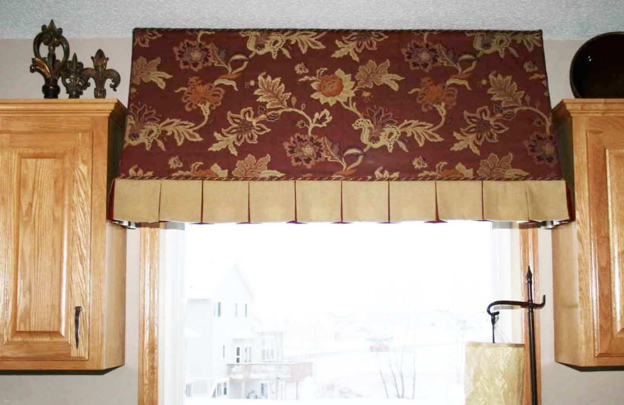 This indoor awning is used over a kitchen window, between the cabinets, to provide a little whimsy and interest. The floral and linen fabrics used compliment each other nicely forming crisp pleats on the bottom of this treatment, finished off with a decorative but complimentary cording between both fabrics.